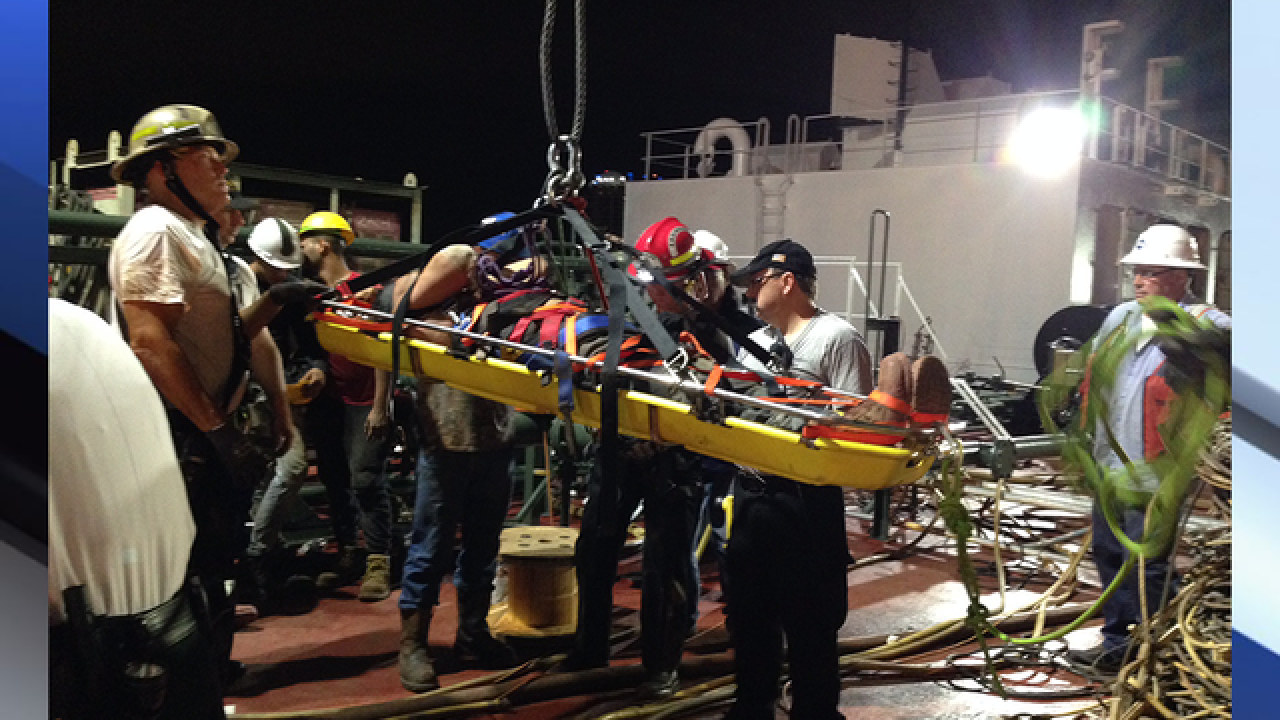 Crews rescue worker who fell inside barge