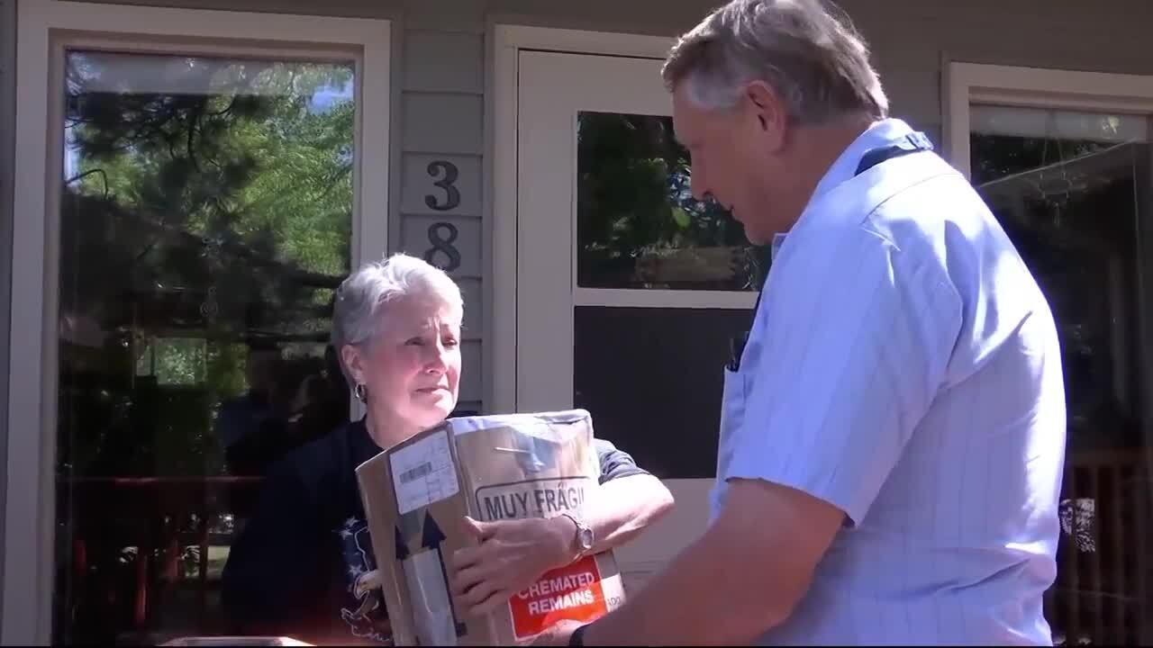 tyler, christine receiving package.jpg