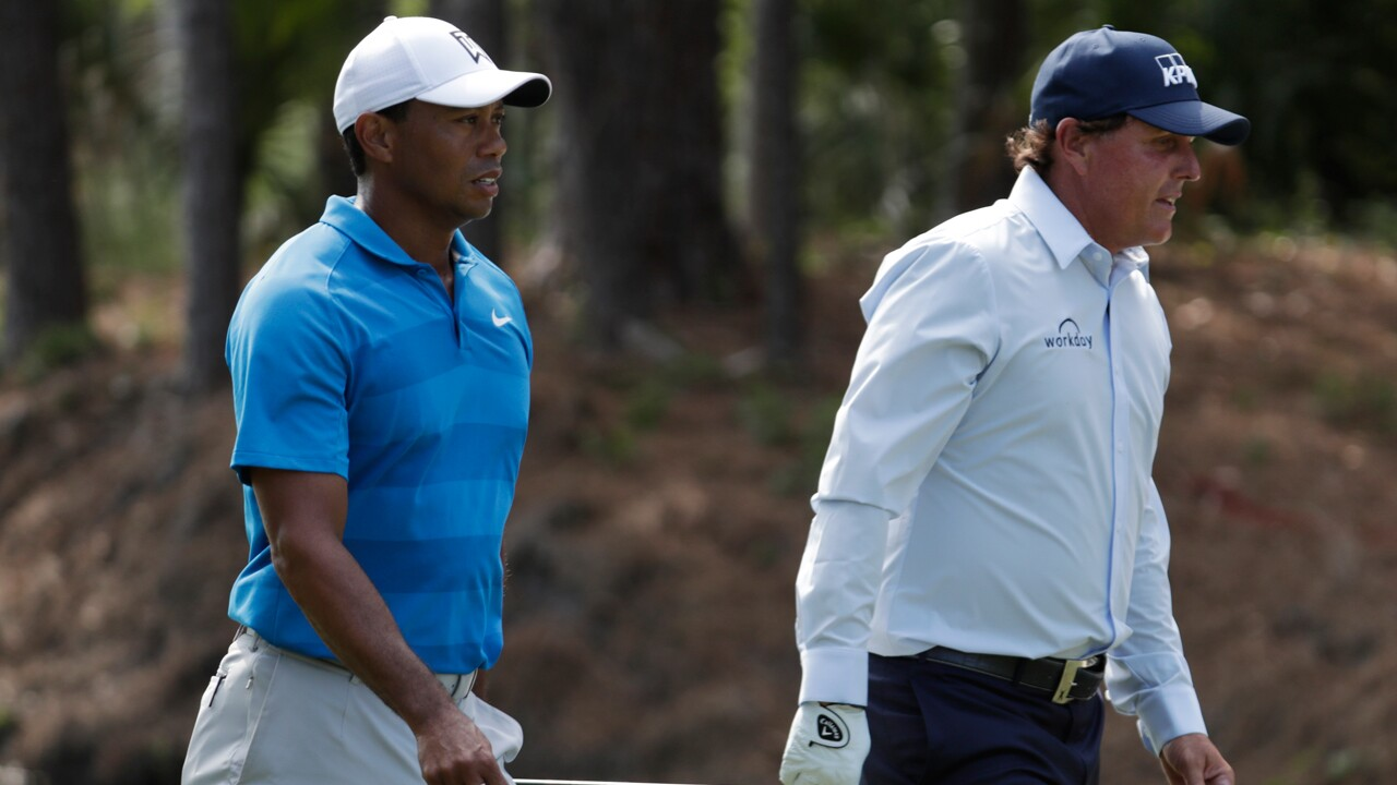 Tiger Woods, left, and Phil Mickelson, right, walks down the 10th fairway during the first round of the Players Championship golf tournament, Thursday, May 10, 2018, in Ponte Vedra Beach, Fla.