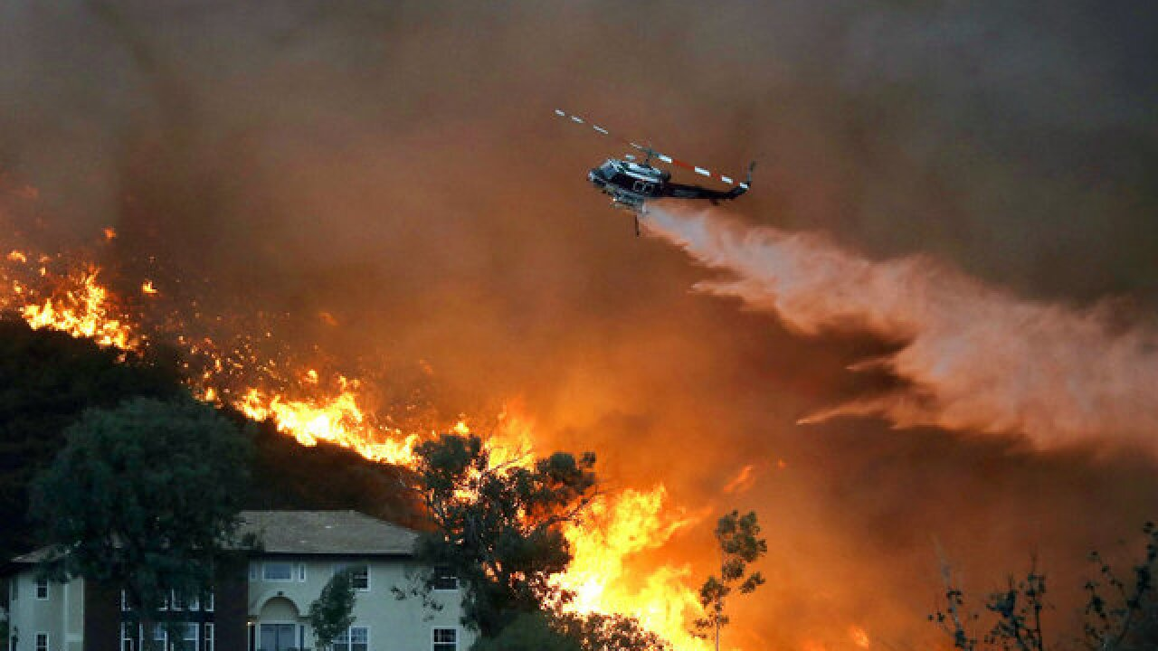 Holy Fire grows in acreage, containment