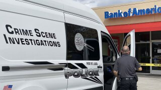 Police investigate a robbery at a Bank of America in Port St. Lucie on Feb. 16, 2021.