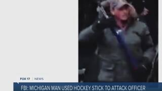 FBI: Man seen beating officer with hockey stick is from MI