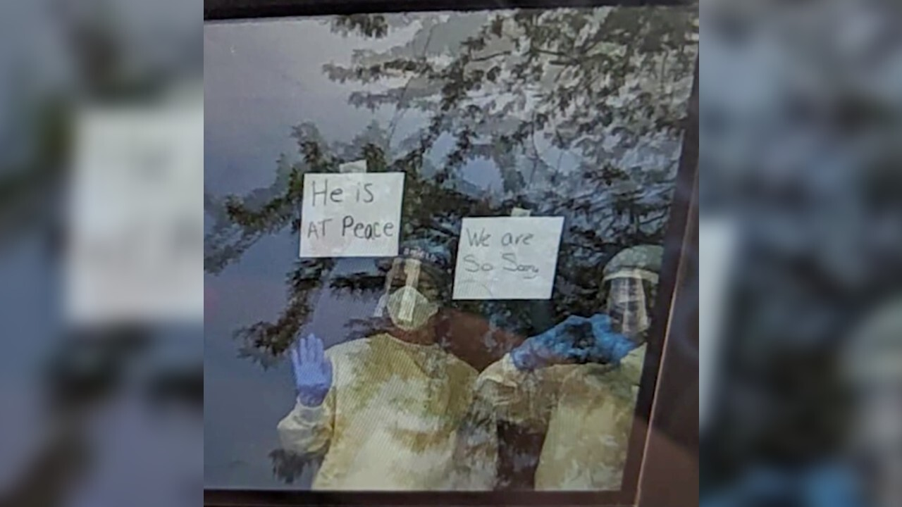 Nurses use signs in window to comfort family who lost dad to COVID-19: 'He is at peace'