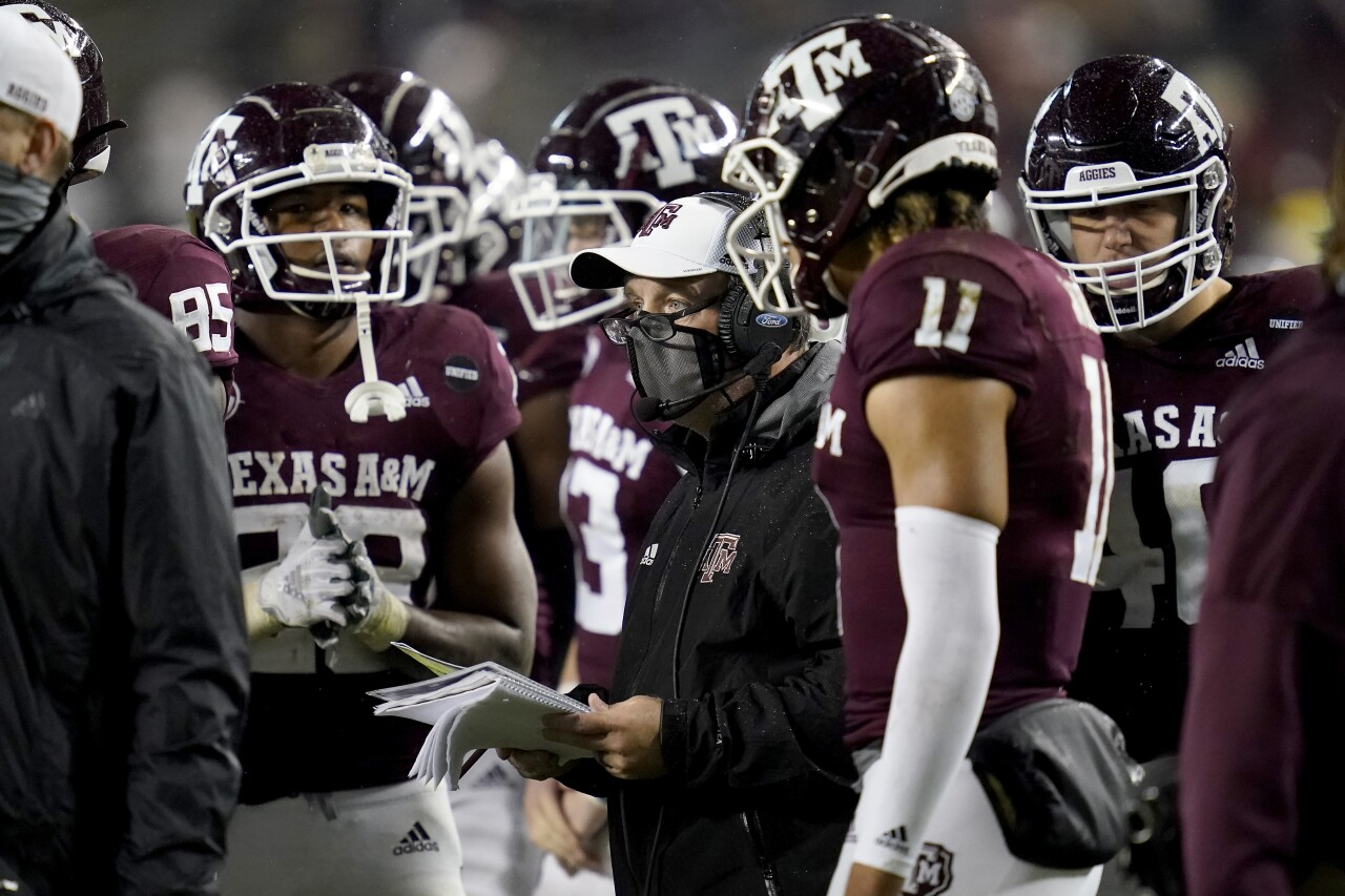Texas A&M Aggies head coach Jimbo Fisher talks to team during timeout in November 2020