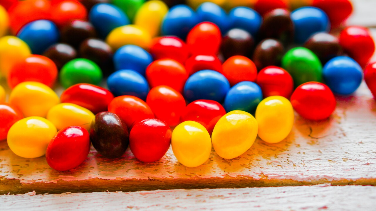 Colorful candies on wooden background candy