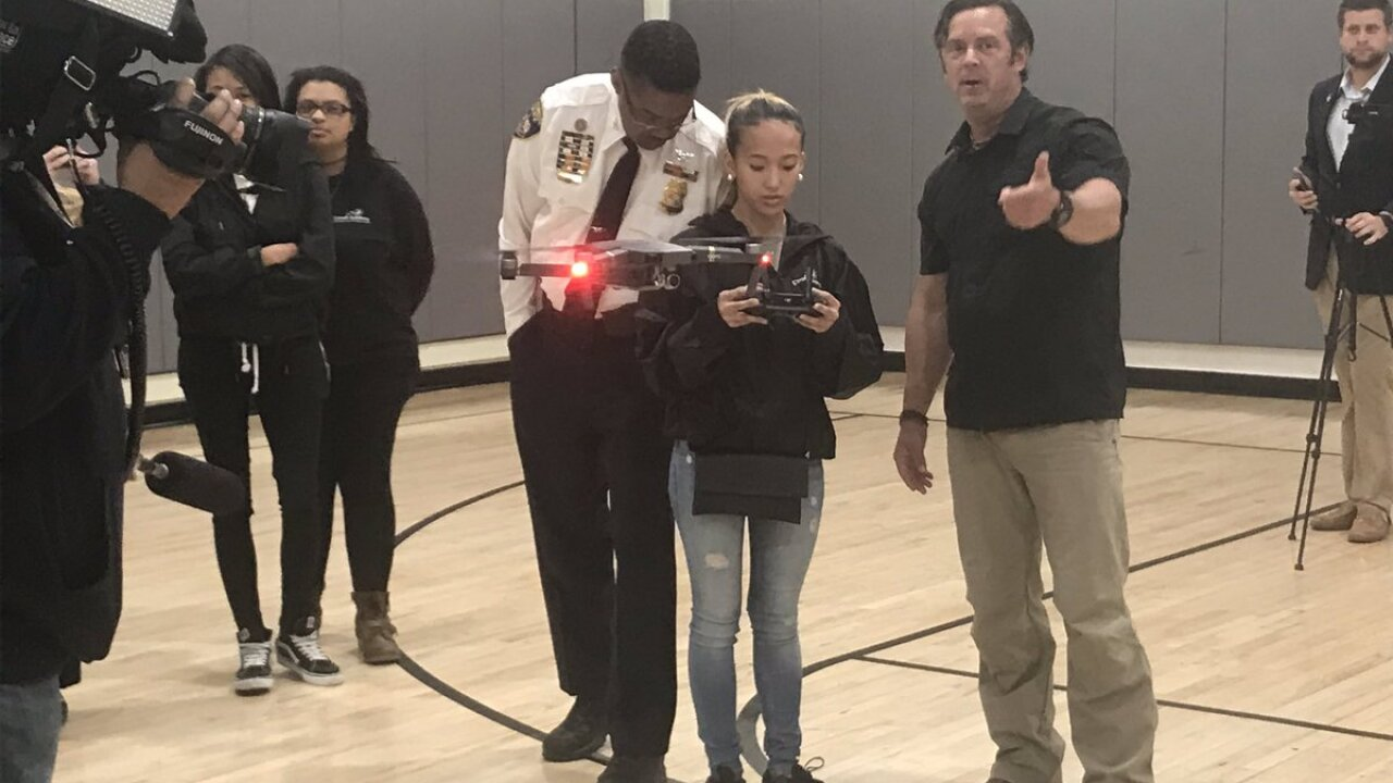 Teens and first responders learning how to fly drones together.