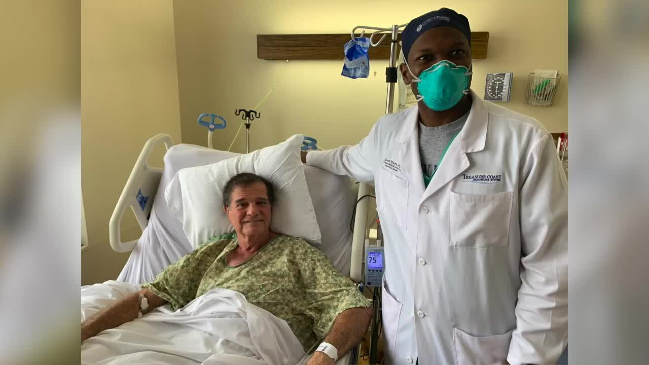 Robert Bassett, bitten by alligator, and Dr. Jason Moore pose for picture in hospital