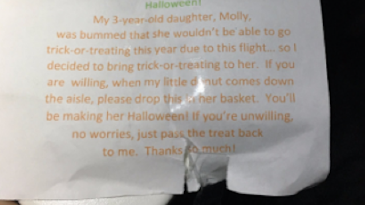 Dad helps daughter celebrate Halloween on plane
