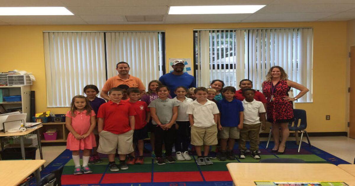 52d2bca121b07 Tiger Woods visits Limestone Creek Elementary in Jupiter