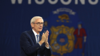 Governor Tony Evers with Wisconsin state flag in background