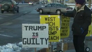 donald trump protest sign battle creek 121819.jpg