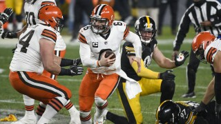 Cleveland Browns QB Baker Mayfield scrambles out of pocket at Pittsburgh Steelers in wild-card playoff game, Jan. 10, 2021