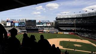 Fans leave Yankee Stadium in New York on Aug. 12, 2019. Frank Franklin II / AP