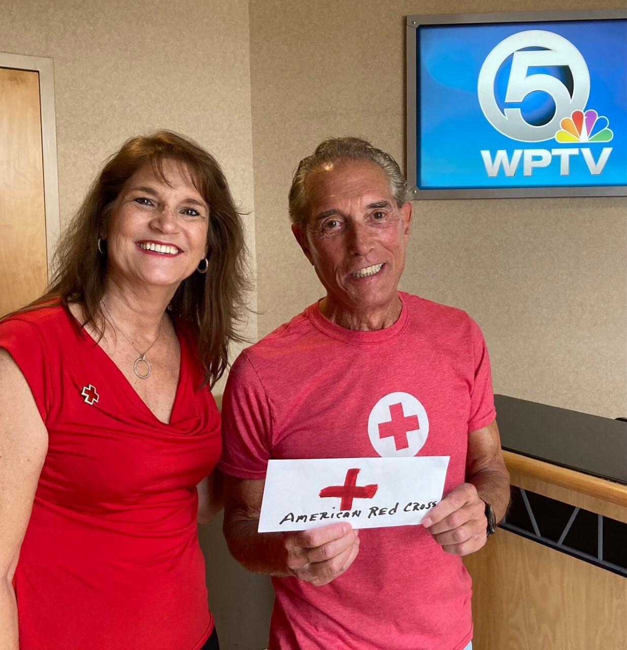 Mark Minkin gives donation to Rose Novotny of the American Red Cross