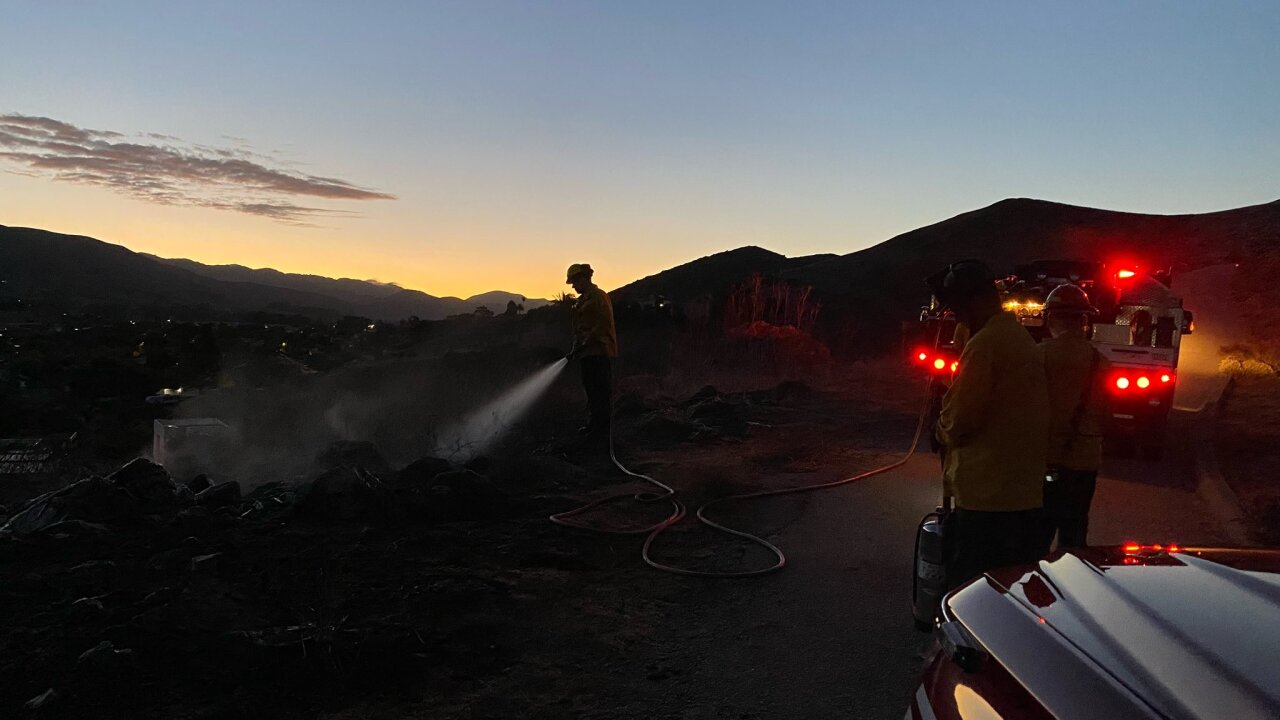 Firefighters responded to a small brush fire on the hillside near Bridge Street.
