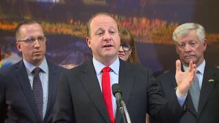 governor jared polis on colorado insurance rates going down.jpg
