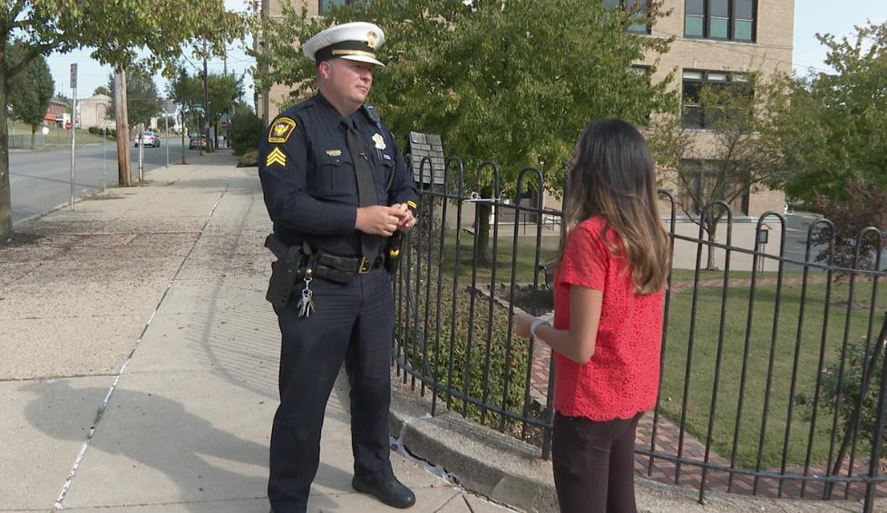 Cincinnati Police Sergeant Jacob Hicks and reporter Paola Suro
