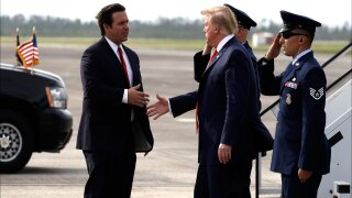 Gov. Ron DeSantis shakes hands with President Donald Trump in May 2019