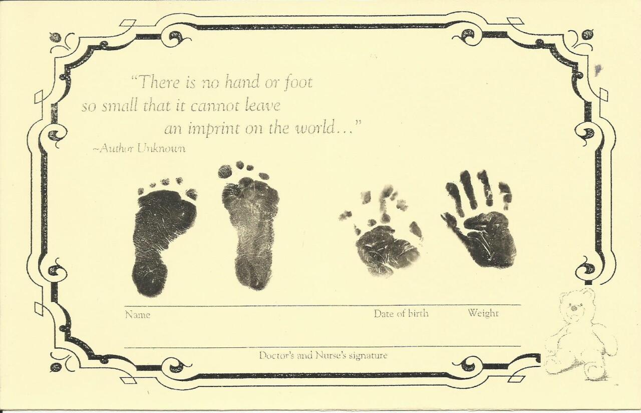 Petey hand and footprints.jpg
