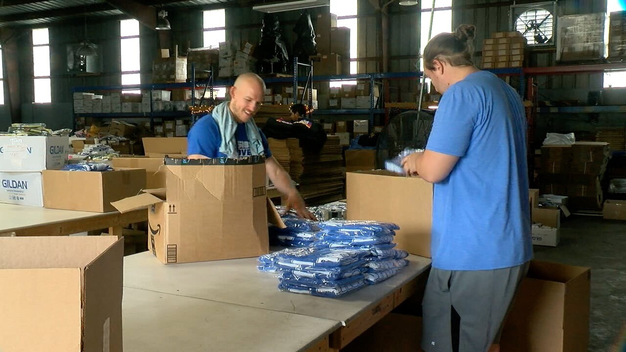 Smack Apparel workers packaging shirts
