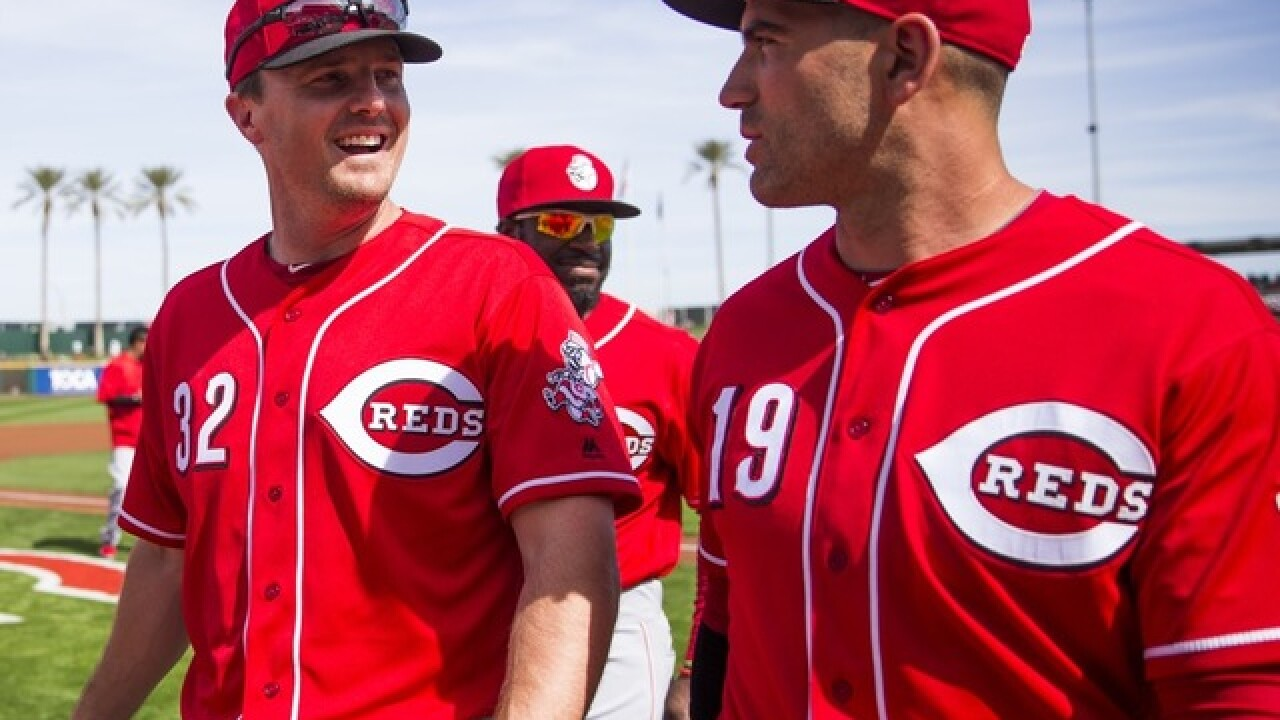 Votto hits first homer, Reds beat Angels 8-5