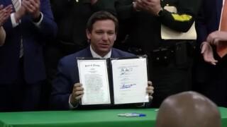 Florida Gov. Ron DeSantis signs the 'anti-riot' bill into law on April 19, 2021.jpg