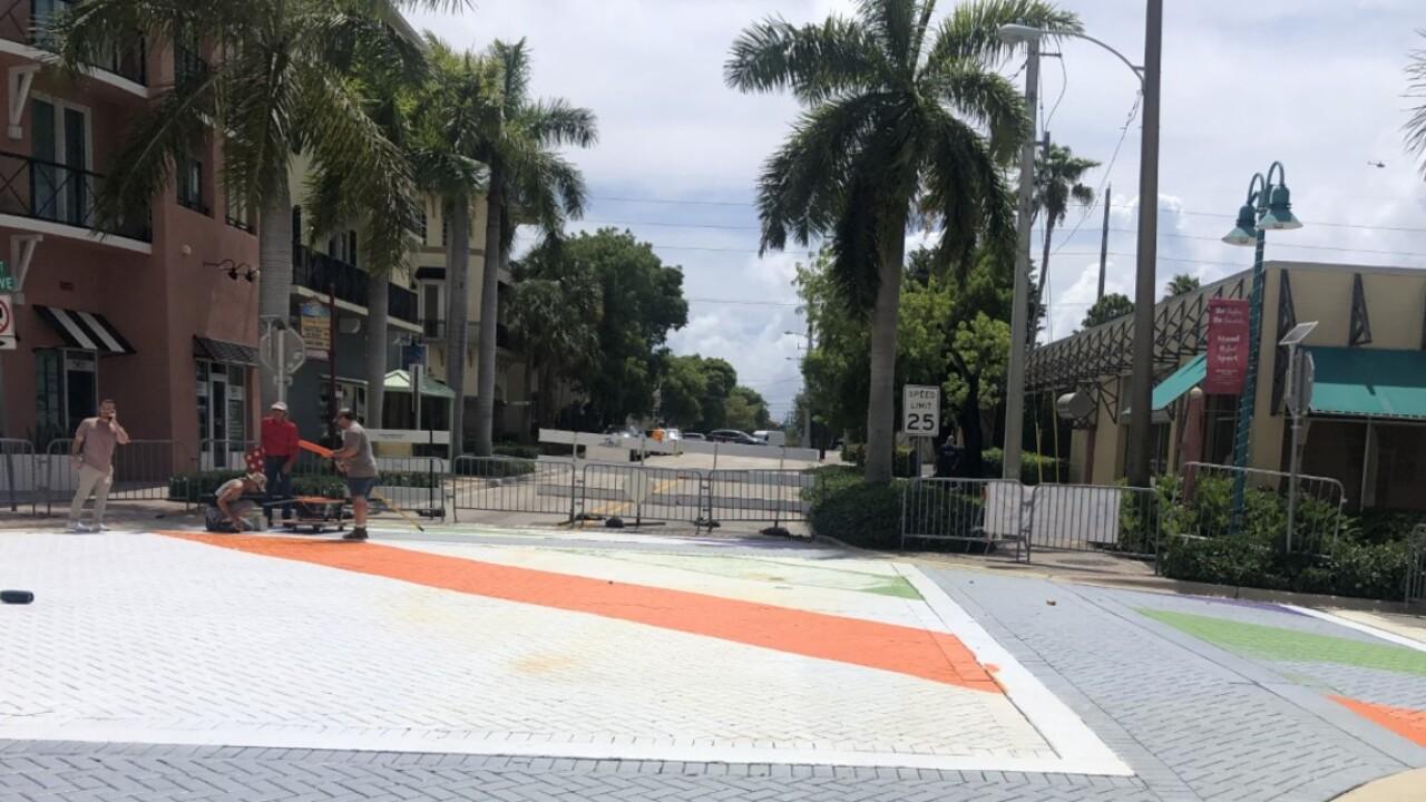 Crews paint a new LGBTQ Pride crosswalk in Delray Beach on June 4, 2021.jpg