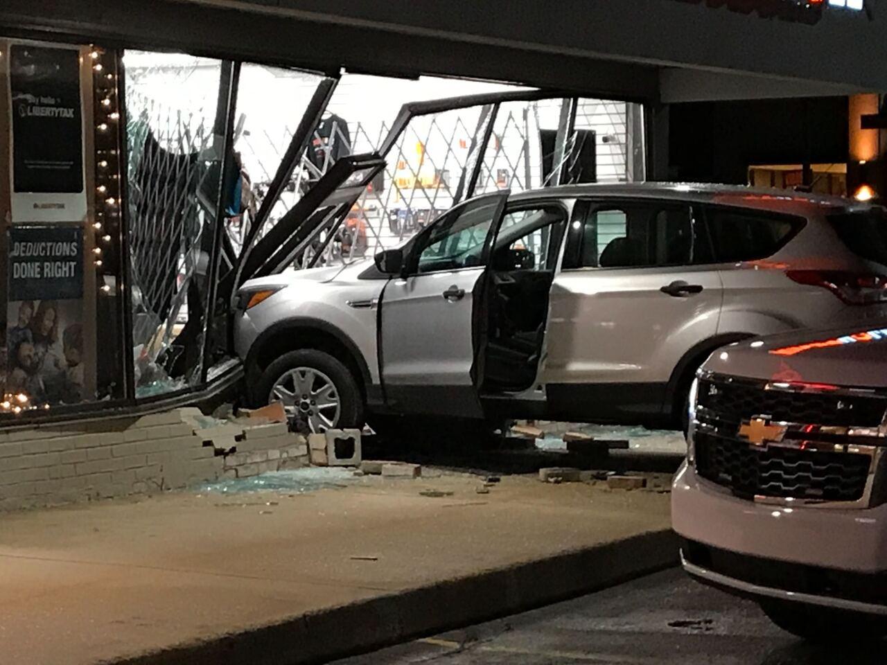 SUV drives through gun store
