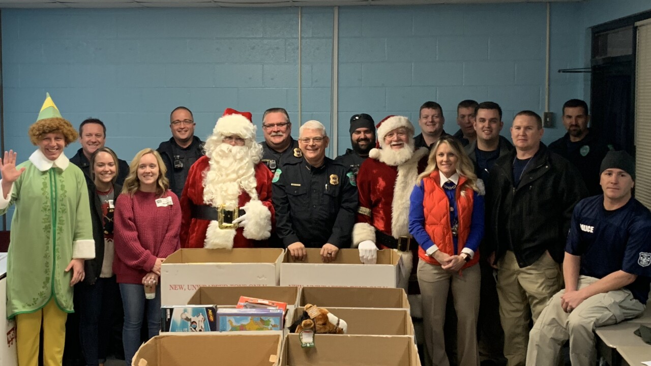 Claremore police delivers gifts