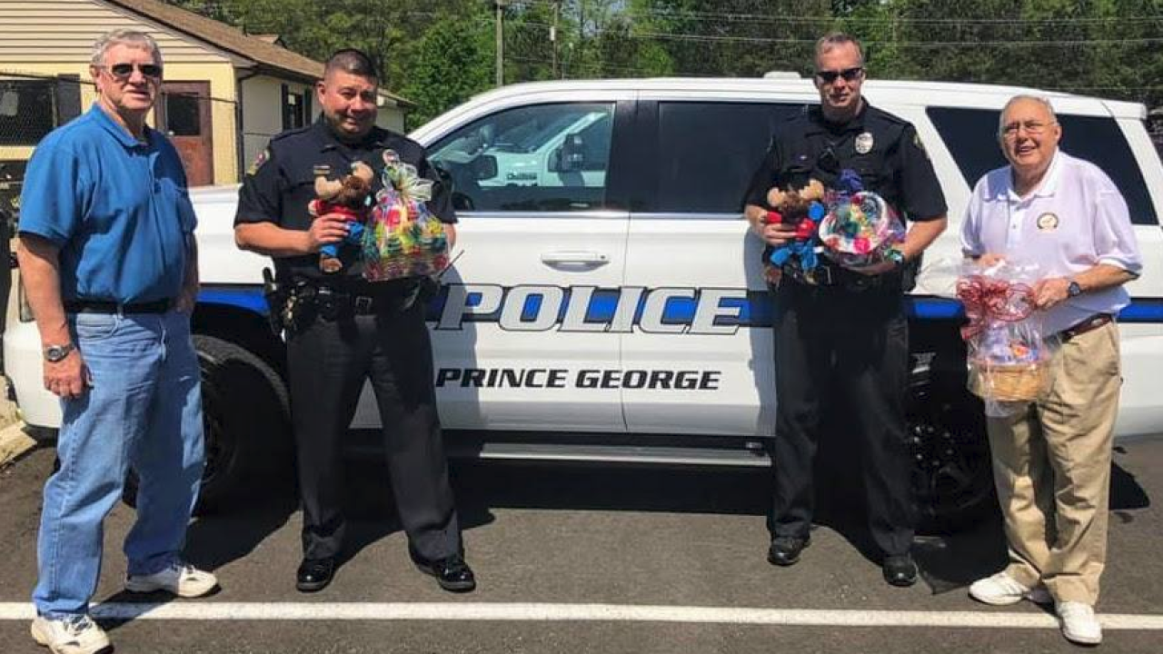 Prince George officers deliver Easter baskets after Moose Lodge fire