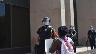 Protestor hit with pepper spray