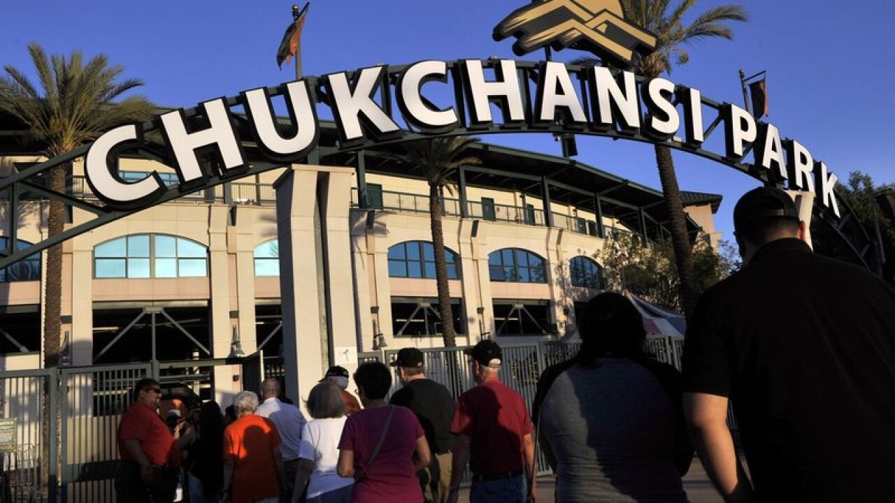 This Sept. 18, 2015 photo shows fans arrive at Chukchansi Park in Fresno, Calif., for a minor-league baseball game between the Fresno Grizzlies and the Round Rock Express. Fresno authorities say a man died shortly after competing in a taco-eating contest at a Grizzlies game. Fresno Sheriff spokesman Tony Botti says 41-year-old Dana Hutchings, of Fresno, died Tuesday, Aug. 13, 2019 shortly after arriving at a hospital. Botti says an autopsy on Hutchings will be done Thursday to determine a cause of death. (Eric Paul Zamora/The Fresno Bee via AP)