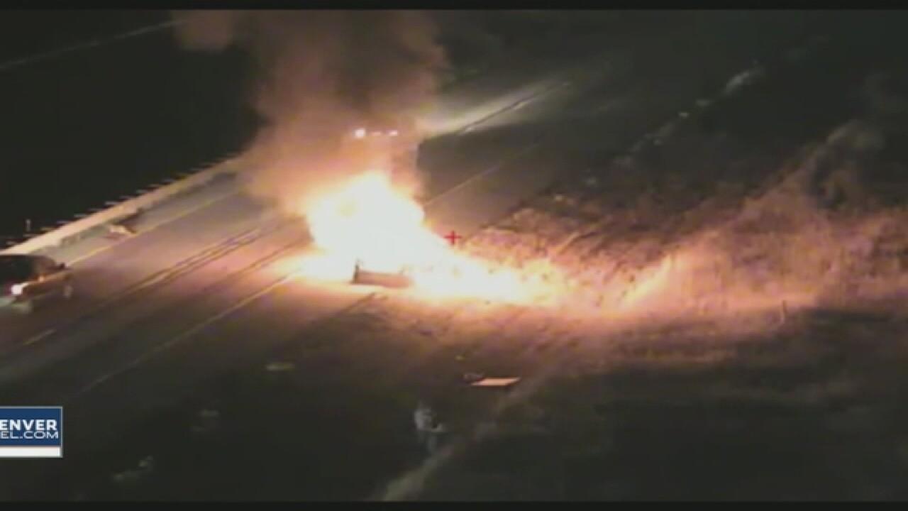 Car hits deer, bursts into flames