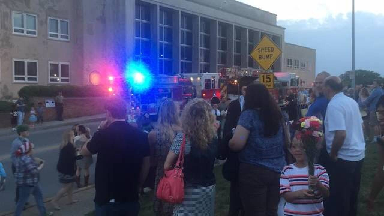 Raymore-Peculiar graduation evacuated due to smoke from lighting fixture
