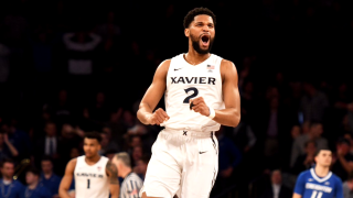 xavier university's kyle castlin celebrates big east.png