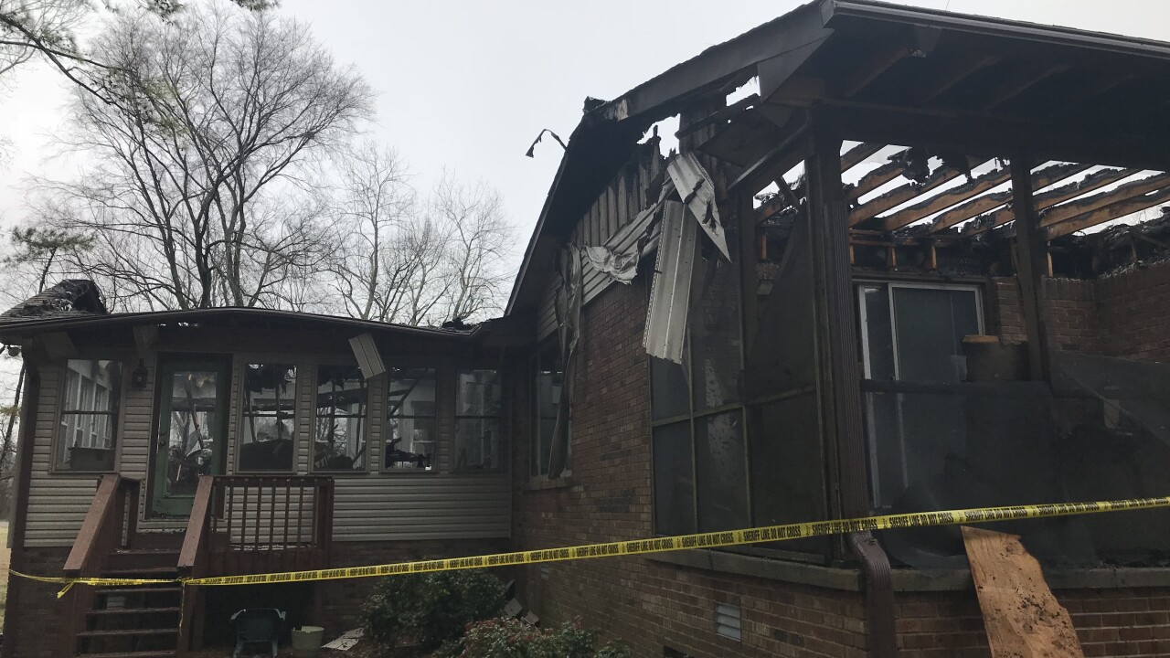 Wife of beloved band director loses home in fire