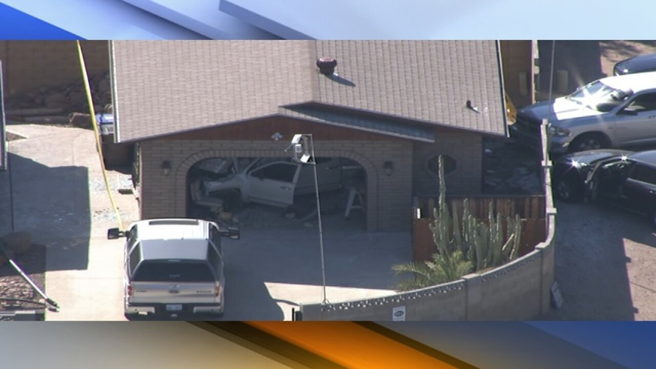 FD: Vehicle crashes into Apache Junction garage