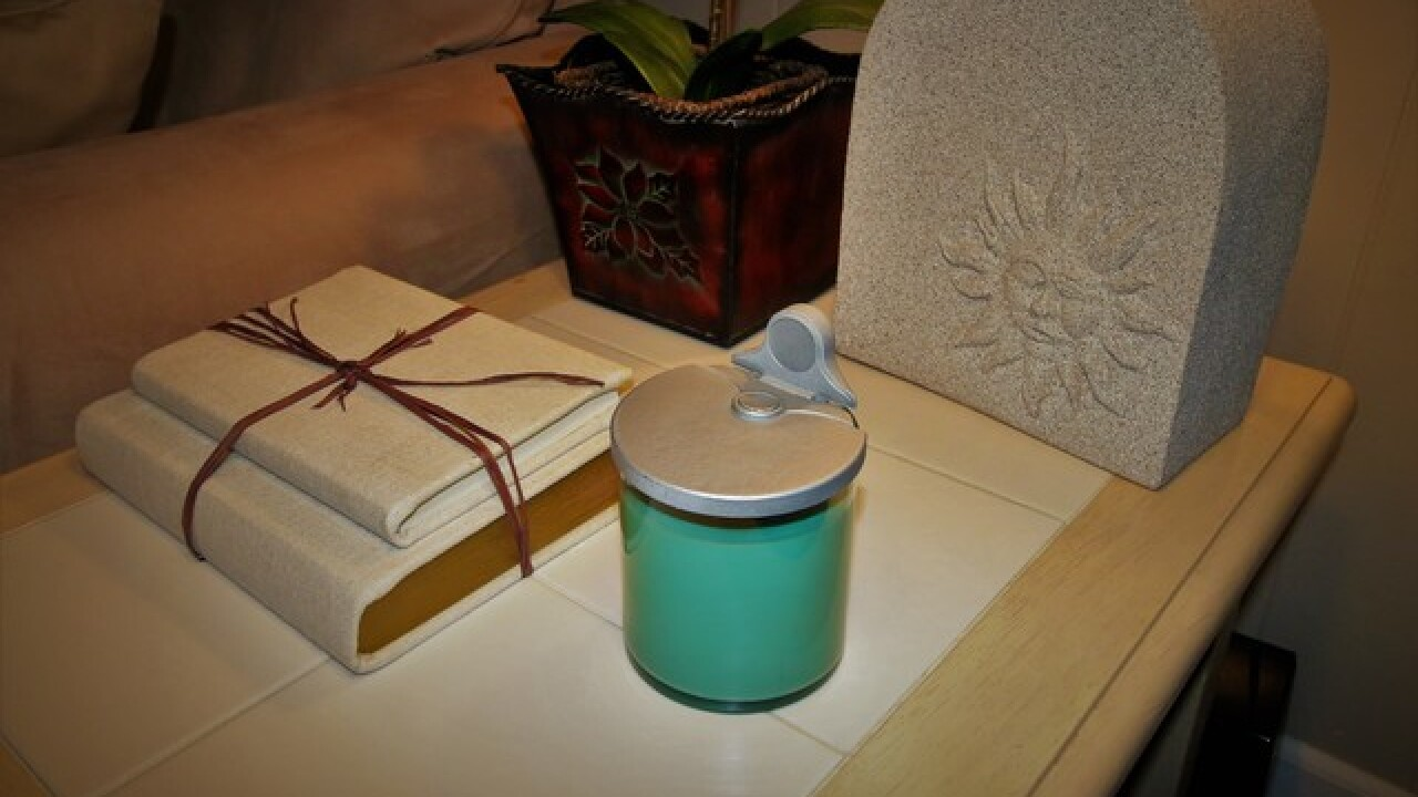 Troy business develops self-extinguishing candle