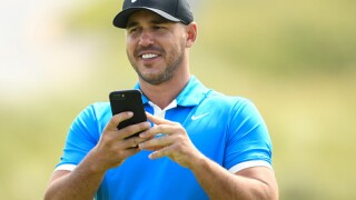Brooks Koepka at British Open with a local lad as his caddie