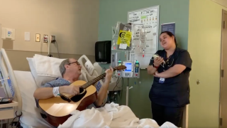 Guitarist undergoing chemo treatment sings heartwarming duet with his nurse