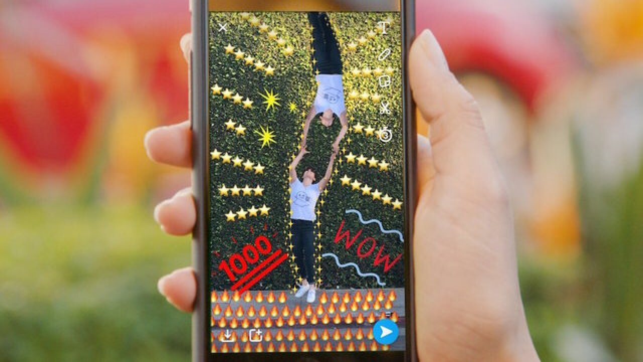 Snapchat battles Facebook, unveils custom Stories
