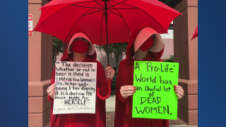 red cloak protest.png