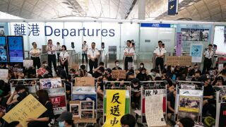 Hong Kong protesters spark airport chaos as flights canceled for second day