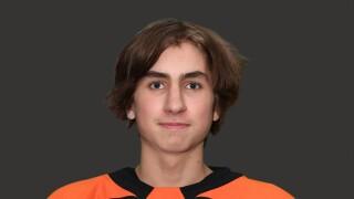 Bryce Permoda poses in Byron Center hockey jersey