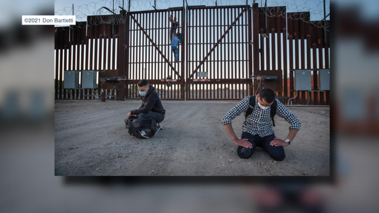 Cubans climb fence at US Mexico border.png