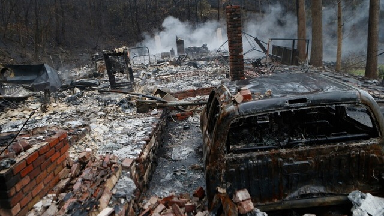 Dazed residents get a look at wildfire rubble