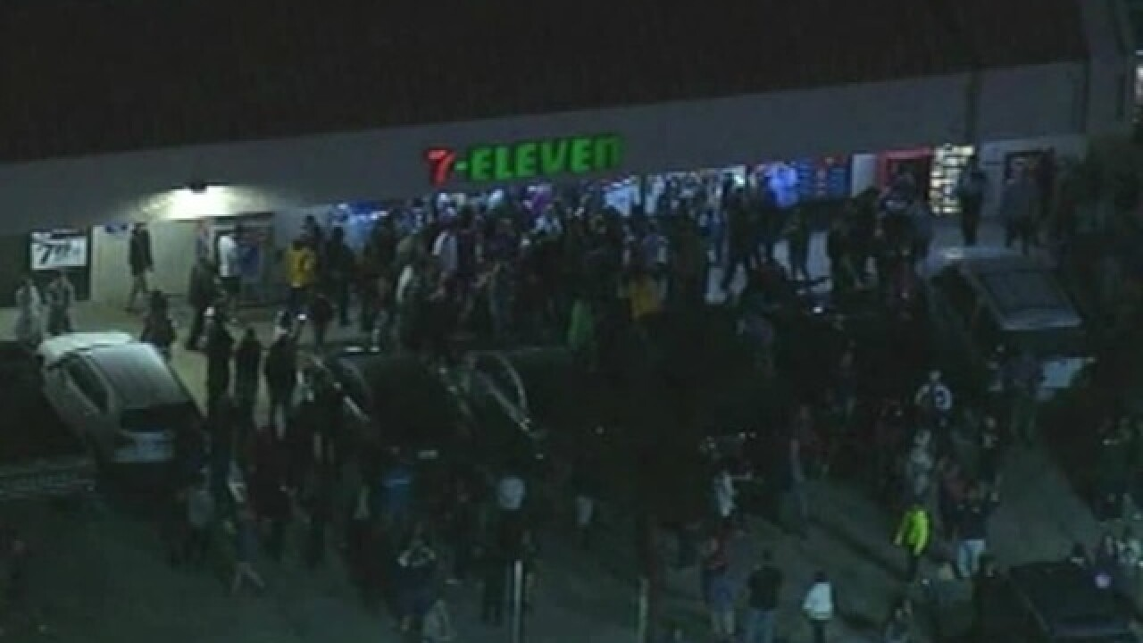 Crowd Gathers At Winning Powerball Ticket Store