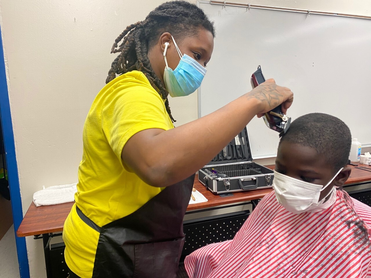 Shantell Johnson cutting hair at Sabal Palm Elementary School