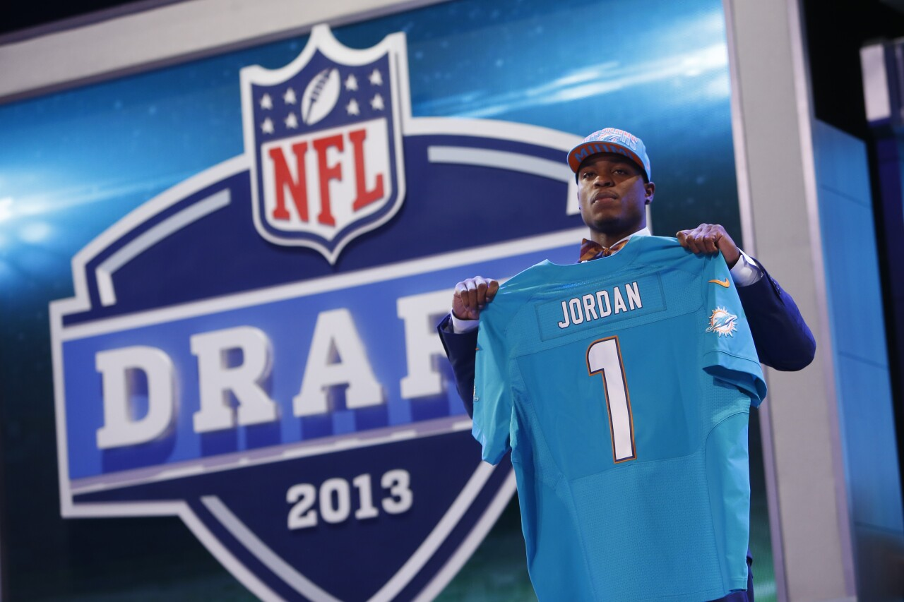 Dion Jordan holds Miami Dolphins jersey during 2013 NFL Draft