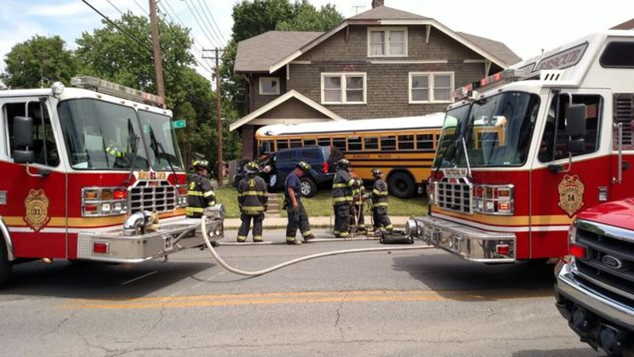 PHOTOS: Bus, car crash into home on north side